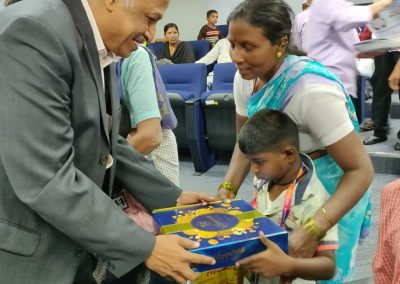 Parthasarathy NS giving away goodies to the children